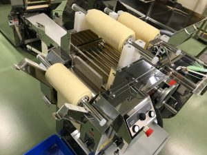 Ramen machine performing combining process